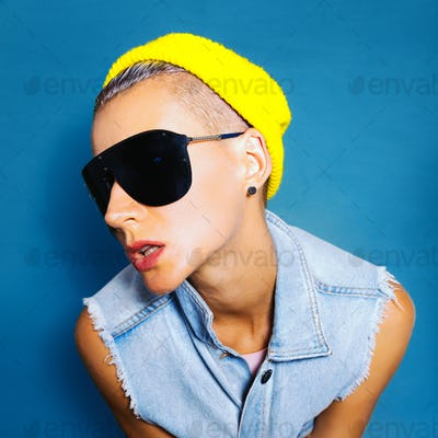 Tomboy style Girl fashion beanie cap and sunglasses. Urban Jeans