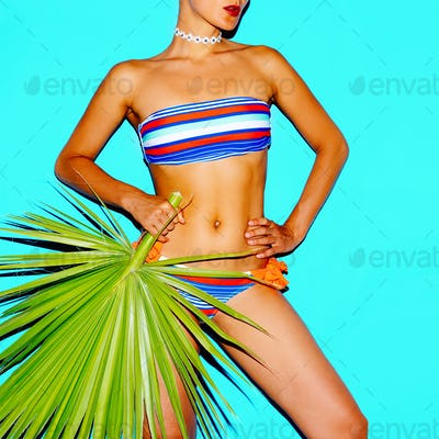 Model beach fashion trend. Striped swimsuit. Minimal style
