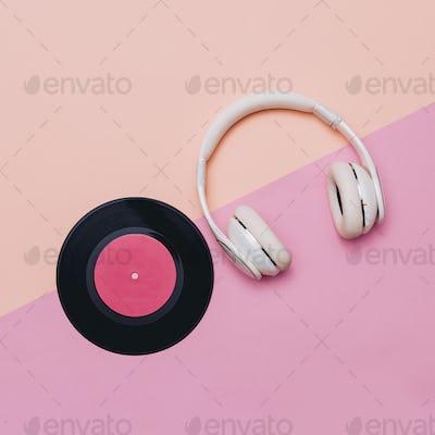 Minimal creative art. Musical retro vibrations. Headphones and v