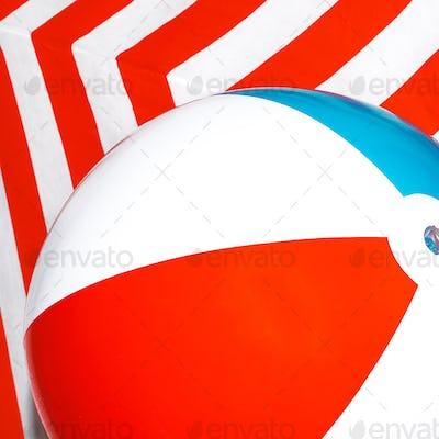 Beach ball on striped background. Minimal