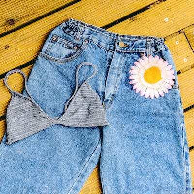 Blue jeans vintage and bra on a wooden background Summer  countr