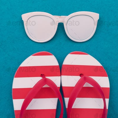 Fashion beach accessories. Sunglasses and flip-flops. Minimal de