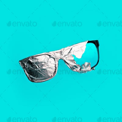 Sunglasses in the aluminum foil. Stillife art