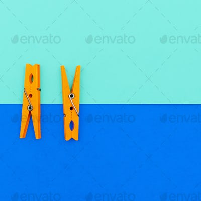 Orange clothespins.minimal art style