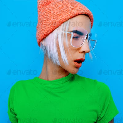 Blonde Model in stylish accessories. Beanie and glasses. Fashion