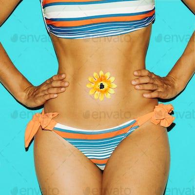 Beach fashion. Fashion striped swimsuit.