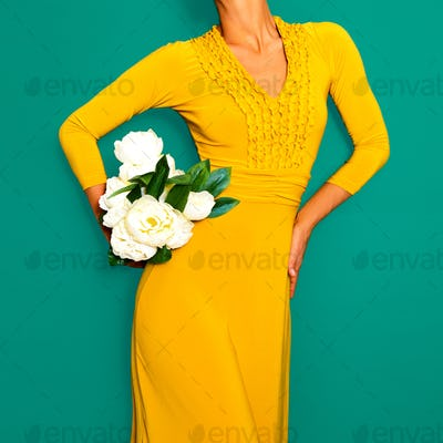 Lady in a stylish yellow vintage dress. Retro chic