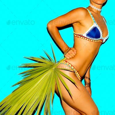 Woman in fashionable Bikini. Tanned body. Beach style