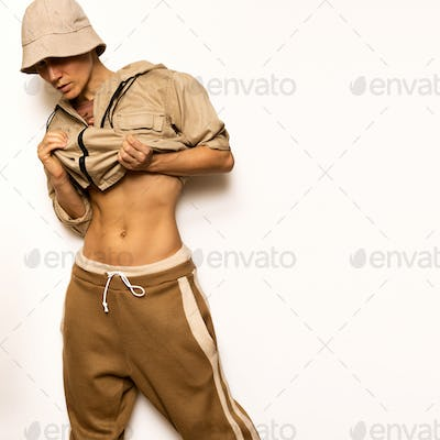 Beige Fashion And Accessories. Panama and jacket. Hip Hop Model