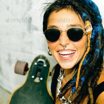 Happy Girl Skater with Dreadlocks. Street style