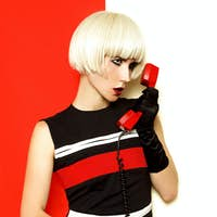 Blond retro style with vintage phone and vintage clothing. Minim