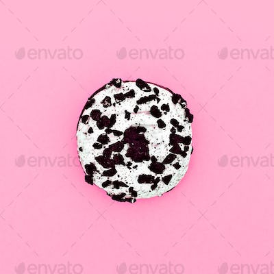 Pretty Donut on a pink background. Minimal. Surreal fashion art