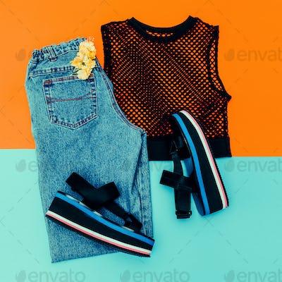 Blue Vintage jeans, platform shoes, black top mesh. Trend of the