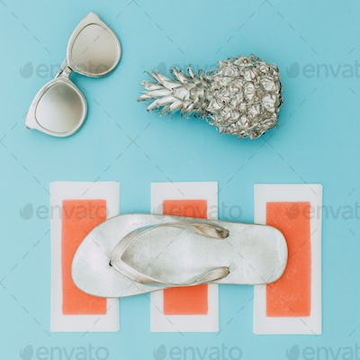 Minimal beach style. Silver set. Pineapple, sunglasses and flip-
