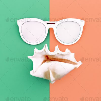 vacation time. Sea style. Shell and sunglasses Minimal art fashi