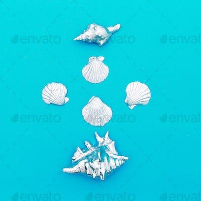 Silver shells on a blue background Minimal art design