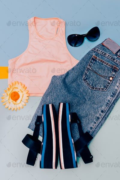 Stylish urban clothing. Sandals platform. Jeans and top. Summer