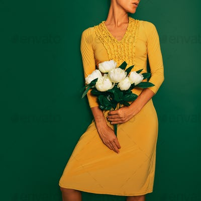Model in vintage yellow dress. Retro style in detail
