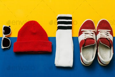 Sneakers, socks, cap, sunglasses. Fashion skateboarder set