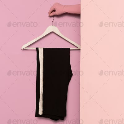 Stylish clothes. Sports trousers. Strip print. Minimal fashion.