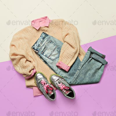 Ladies Fashion Clothes. Pink shirt, sweater and jeans. Glamorous