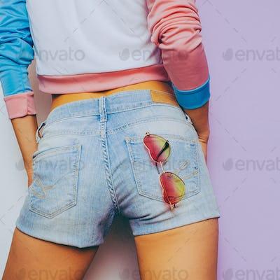 Vanilla Summer. Model in a fashionable T-shirt and denim shorts