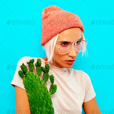 Hipster Blonde Model in stylish accessories. Beanie and glasses.