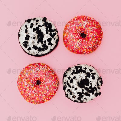 Set Donut on a pink background. Minimal. Surreal fashion art