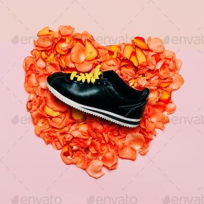 Minimal creative design. Glamorous shoes flowers background. Spr