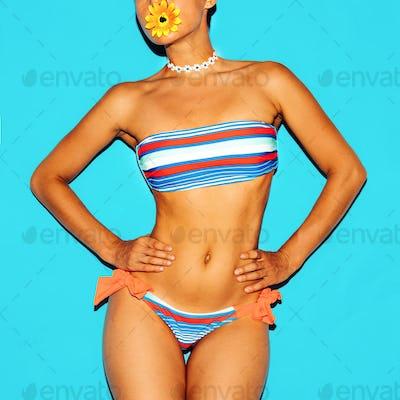 Beach Fashion Lady. Fashionable striped swimsuit.