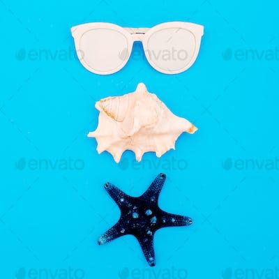 Sea set. Shells and sunglasses. Minimal design