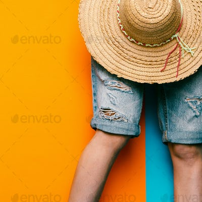 Denim shorts and straw hat. minimal style urban fashion