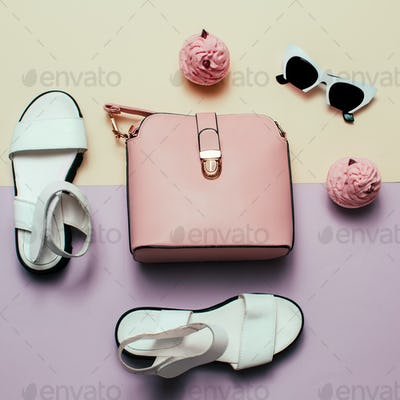 Ladies Fashion Accessories. Pink bag and sunglasses. Trendy sand