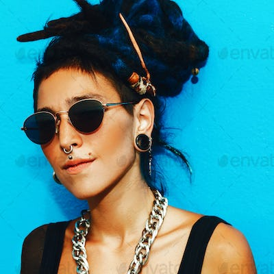 Fashion Spanish Girl with dreadlocks and stylish accessories on