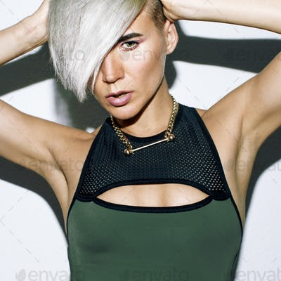 Stylish blonde with short hair Fashion trend Tomboy Lady