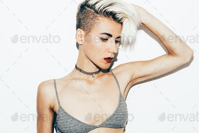Casual fashion style. Tom boy hipster blond model in stylish acc