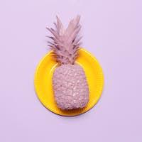 Pineapple in pink paint Surreal minimal artStillife