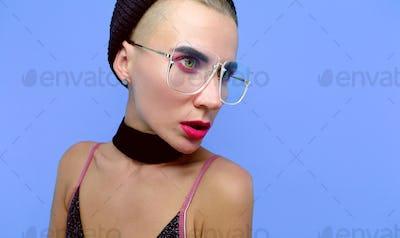 Sensual Tomboy model in fashionable glasses and choker accessori