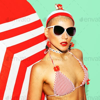Pretty Blonde Beach Style. Fashionable swimsuit and accessories.