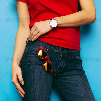 Model in stylish clothes and accessories. Outfit Jeans, shirt, r
