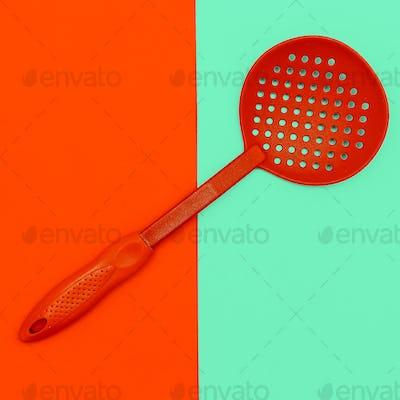 Kitchen accessories. Spoon of a colanderMinimal art style