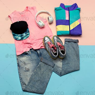 Stylish set. Fashionable jeans and sneakers. Accessories Headpho