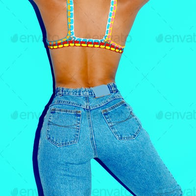 Model in fashionable swimsuit and jeans. Vintage style