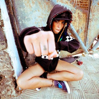 Young girl hip hop style. Urban street fashion. Skateboard life