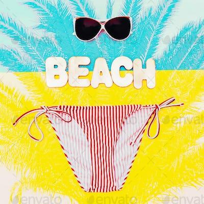 Beach time. Stylish Bikini And Sunglasses For The Lady
