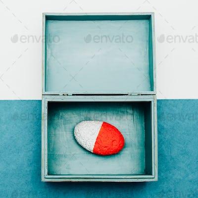Ocean souvenirs. Stone in the box. Minimal design.