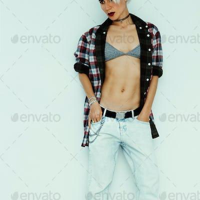 Casual summer fashion style. Tom boy model in stylish checkered