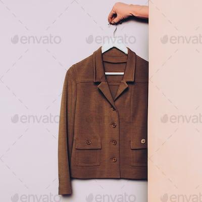Stylish clothes. Vintage jacket on a hanger. wardrobe ideas tren