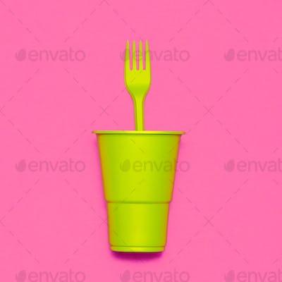 Plastic tableware. Minimal. Plastic cup and fork