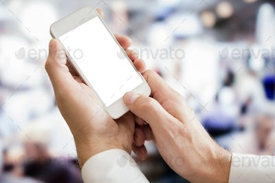 Businessman holding blank screen smartphone